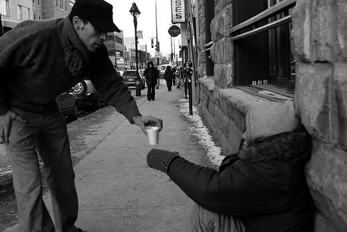 Giving to the poor street photo |  Bible verses on helping the homeless